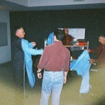 Setting up a scene to demonstrate the possible blood spatter during the murders.